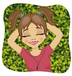 Little girl lying on grass listening to music vector