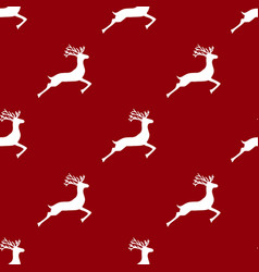 seamless pattern reindeer on a red background vector image
