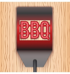 Barbecue hot metal spatula on wooden background vector
