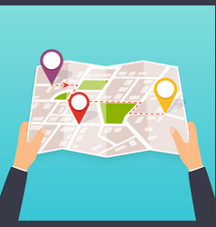hand holding a paper map with points tourist look vector image