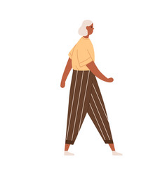 Senior gray-haired woman walking in modern casual vector