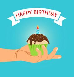 hand holding cupcake birthday vector image