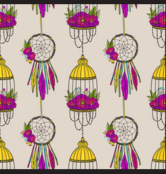 Seamless pattern with dream catcher and bird cage vector