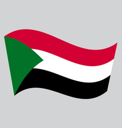 Flag of sudan waving on gray background vector