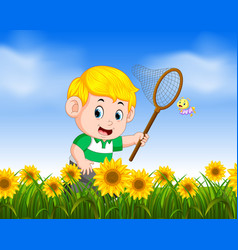 young boy catching butterfly in the jungle vector image