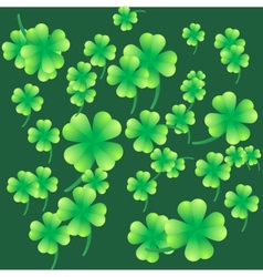 Leaves of clover on a green background vector image