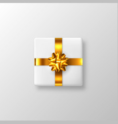 white gift box with golden bow and ribbon vector image