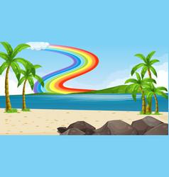 beach landscape scene with rainbow in sky vector image