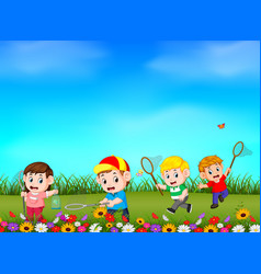 cartoon kids catching butterfly in the garden vector image