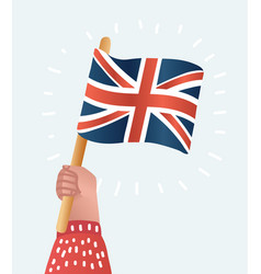 hand holds the flag of great britain vector image