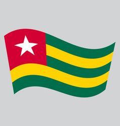 flag of togo waving on gray background vector image vector image