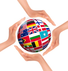 Hands holding globe with flags of world vector image