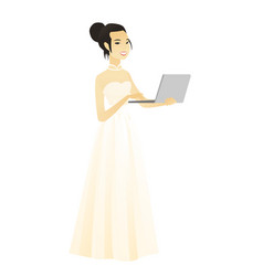 Asian bride in a white dress using a laptop vector
