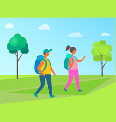 couple man and woman with backpacks walk forest vector image
