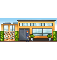 An engineer in front of a new building vector