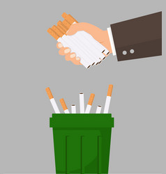 Hand putting cigarettes in trash bin concept vector