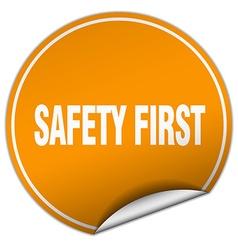 Safety first round orange sticker isolated on vector