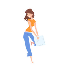happy girl in pajama playing pillow fight vector image