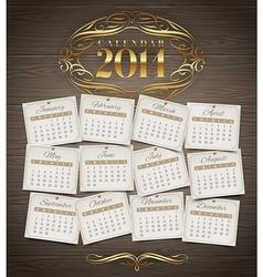 Calendar of 2014 with golden decor vector