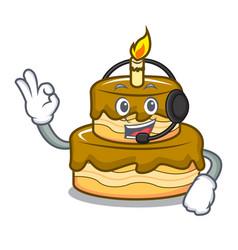 With headphone birthday cake mascot cartoon vector