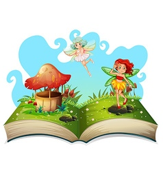 Book of fairies flying in the garden vector