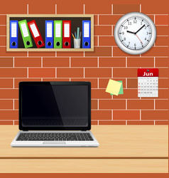 laptop on designer desktop in modern office vector image