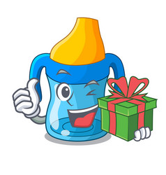 With gift cartoon baby drinking from training cup vector