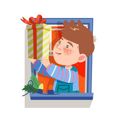 Freckled boy in window holding wrapped gift vector