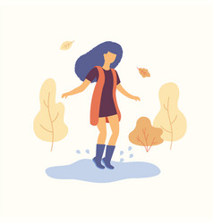 girl is jumping on the puddle autumn concept vector image