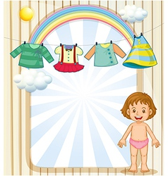 A baby below the hanging clothes vector image vector image