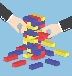 Businessman hands play wood block tower game vector
