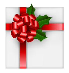 Christmas gift with red bow and holly vector