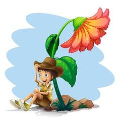 A boy wearing a hat sitting below the giant flower vector