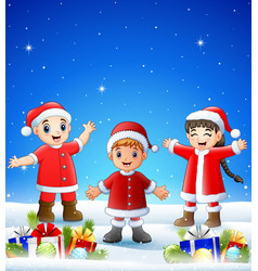 cartoon kids wearing santa costume in the winter b vector image