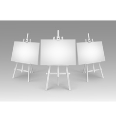 White wooden easels with empty blank canvases vector