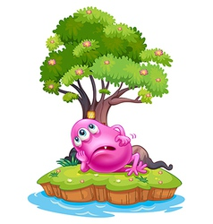 A pink beanie monster resting under the tree house vector image