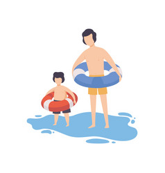 father and son dressed in inflatable rubber vector image
