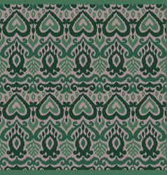 Ikat ornament ethnic seamless pattern vector