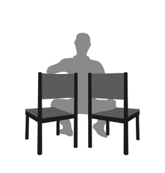 Silhouette of a man sitting in a two chair vector image