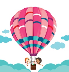 Two girls in balloon floating on the sky vector image