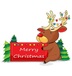 A deer holding a christmas card vector image vector image