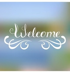 Welcome - hand lettering on blurred background vector image
