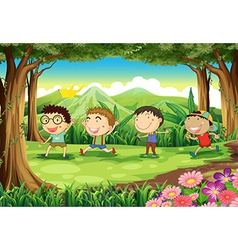 Four playful kids at the forest vector image