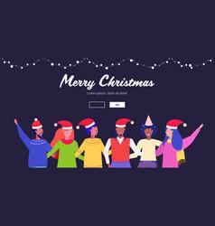 people in santa hats having fun mix race men women vector image