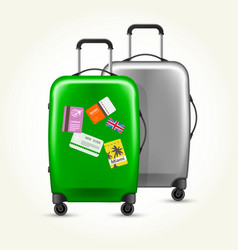 wheeled suitcases with travel tags - baggage vector image