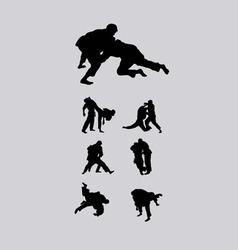 Jiu-jitsu and judo wrestlers silhouettes vector