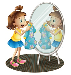 A girl looking at the mirror with her dress vector