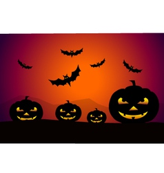 Pumpkins at halloween night vector