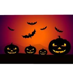 pumpkins at Halloween night vector image
