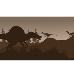 Silhouete of spinosaurus and eoraptor in hills vector